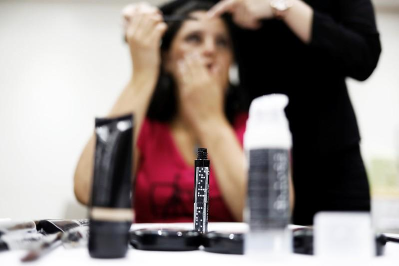A bottle of Black Mascara with Braille writing on it is seen as Maria, 44, who is blind, gets make up put on during a cosmetics class set up to help boost self esteem at the Laramara association in Sao Paulo, Brazil April 18, 2018. Nacho Doce