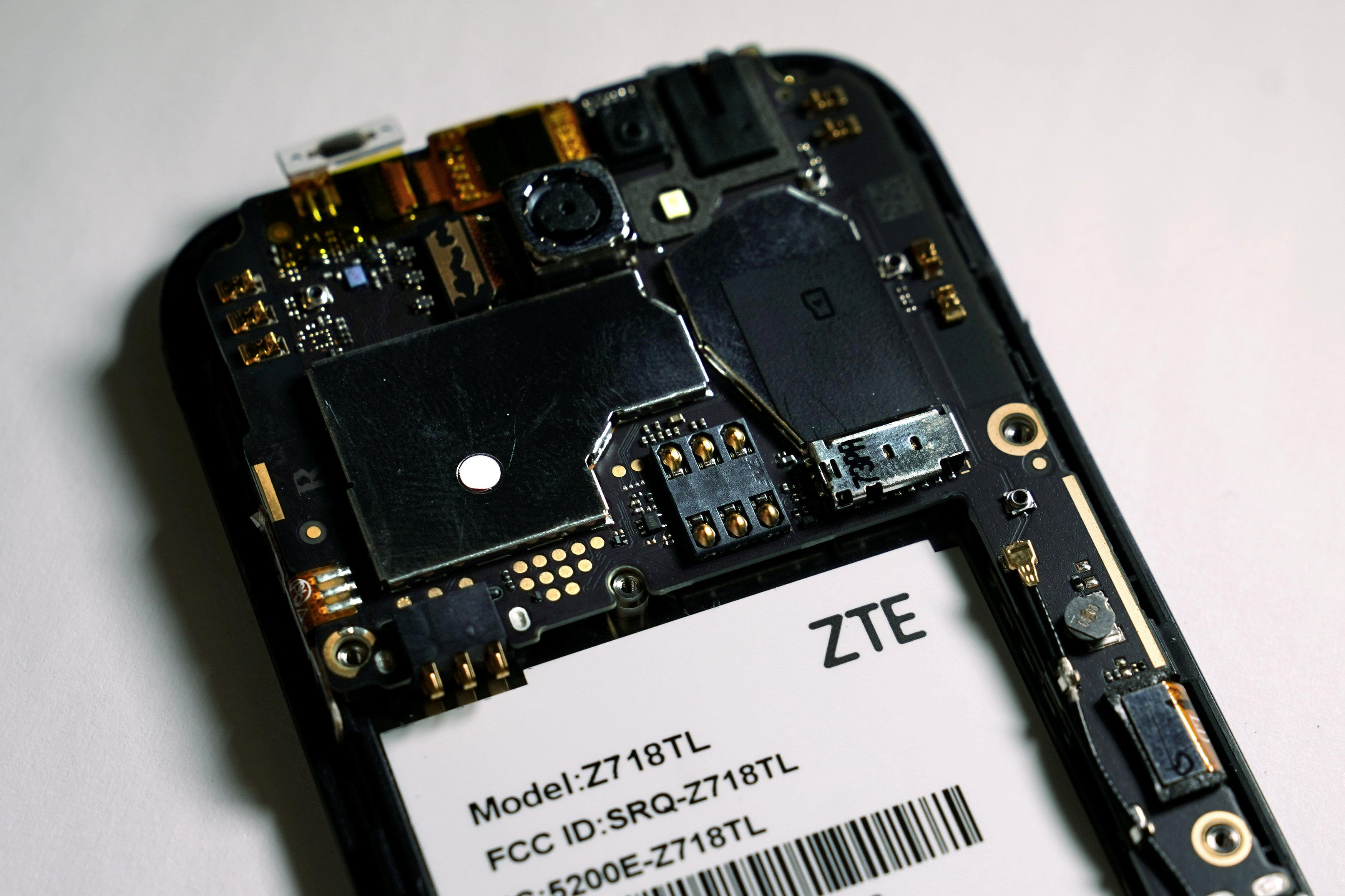 The inside of a ZTE smart phone is pictured in this illustration taken April 17, 2018. Carlo Allegri/Illustration