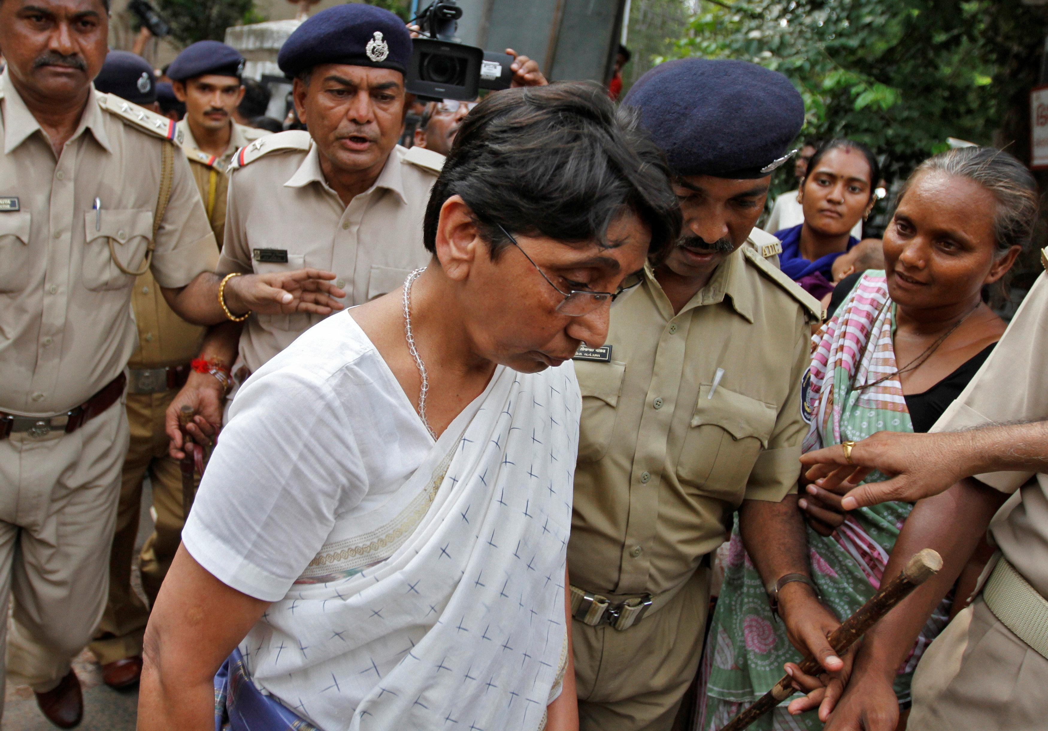 Maya Kodnani, a sitting lawmaker from the state's ruling Hindu nationalist Bharatiya Janata Party (BJP) and Gujarat minister for women and child development between 2007-2009, arrives at a court in the western Indian city of Ahmedabad August 31, 2012. Amit Dave