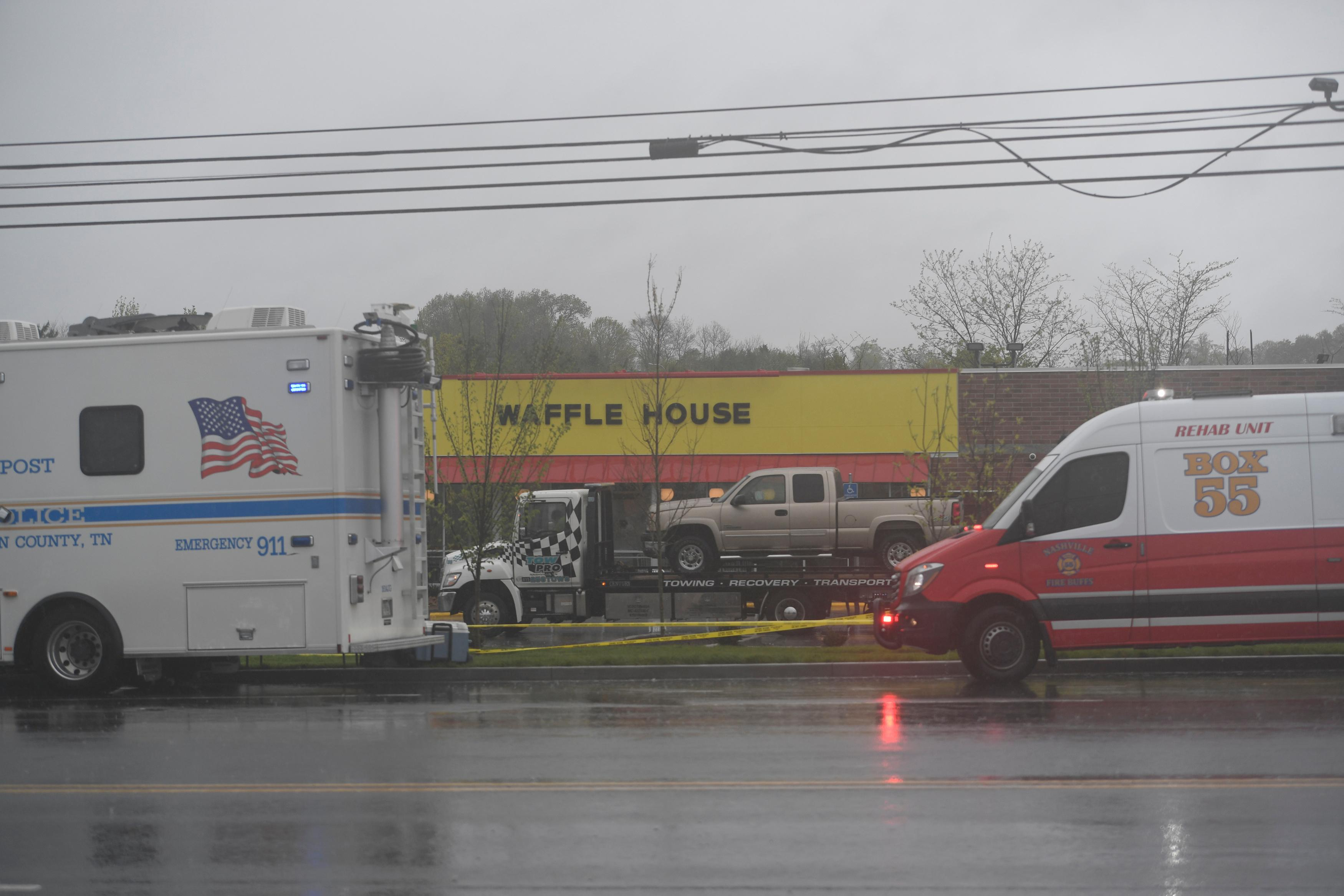 The truck of Travis Reinking, the suspected shooter, is loaded on a trailer ready to be towed from the scene of a fatal shooting at a Waffle House restaurant near Nashville, Tennessee, U.S. April 22, 2018.  Harrison McClary