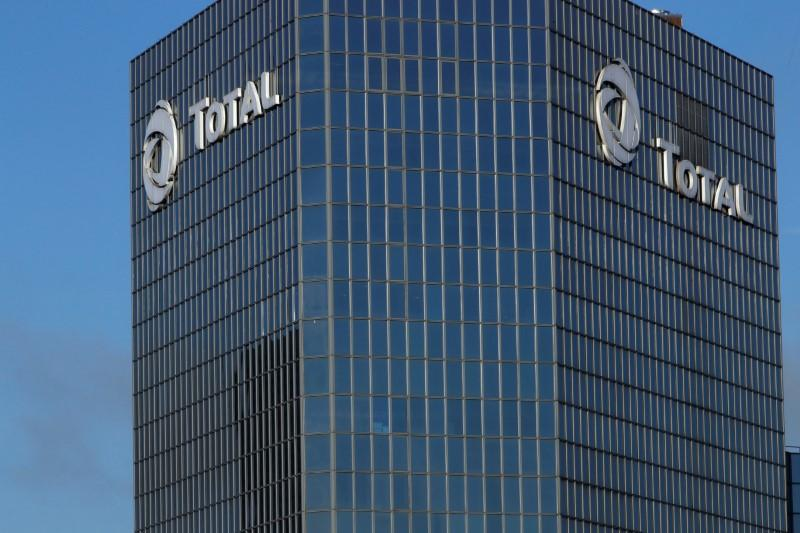 The logo of Total is seen on the headquarters tower of French oil giant Total at La Defense business and financial district in Courbevoie, near Paris, France, December 18, 2017.   Philippe Wojazer