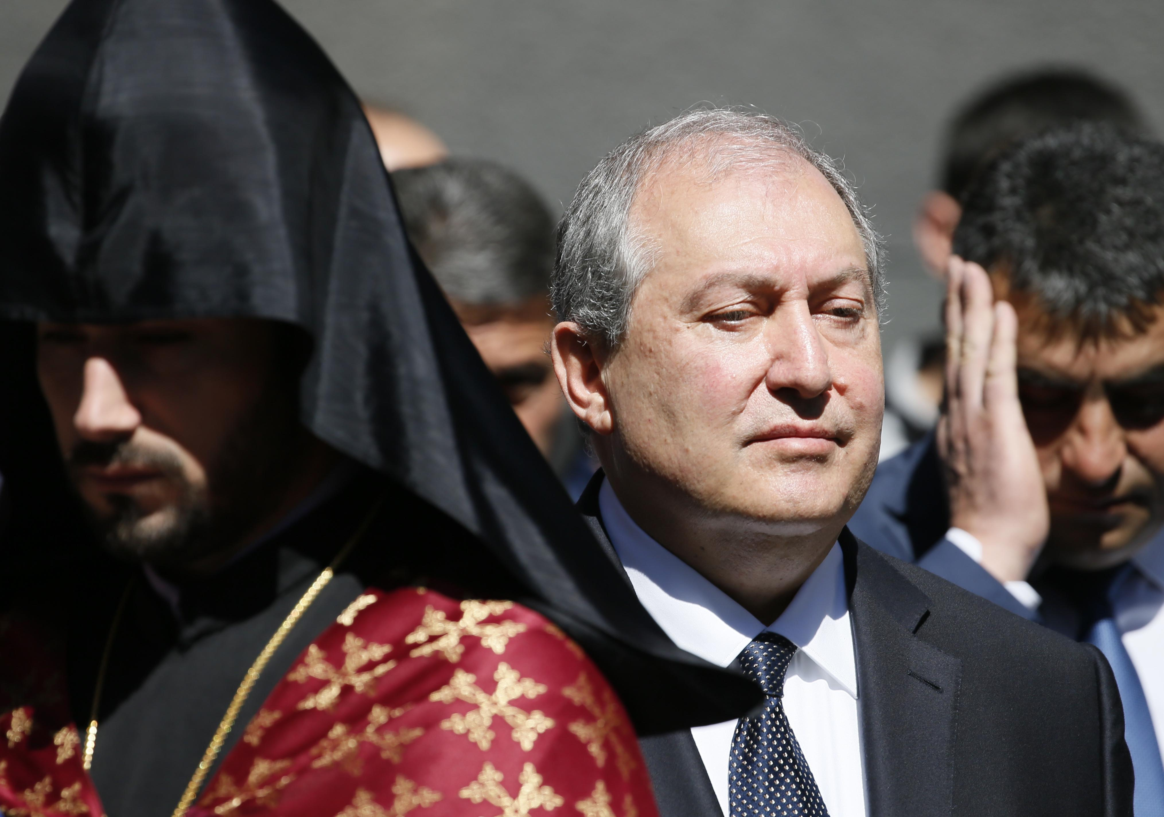 Armenian President Armen Sarkissian attends a wreath laying ceremony to commemorate the 103rd anniversary of mass killing of Armenians by Ottoman Turks, at the Tsitsernakaberd Memorial Complex in Yerevan, Armenia April 24, 2018. Gleb Garanich