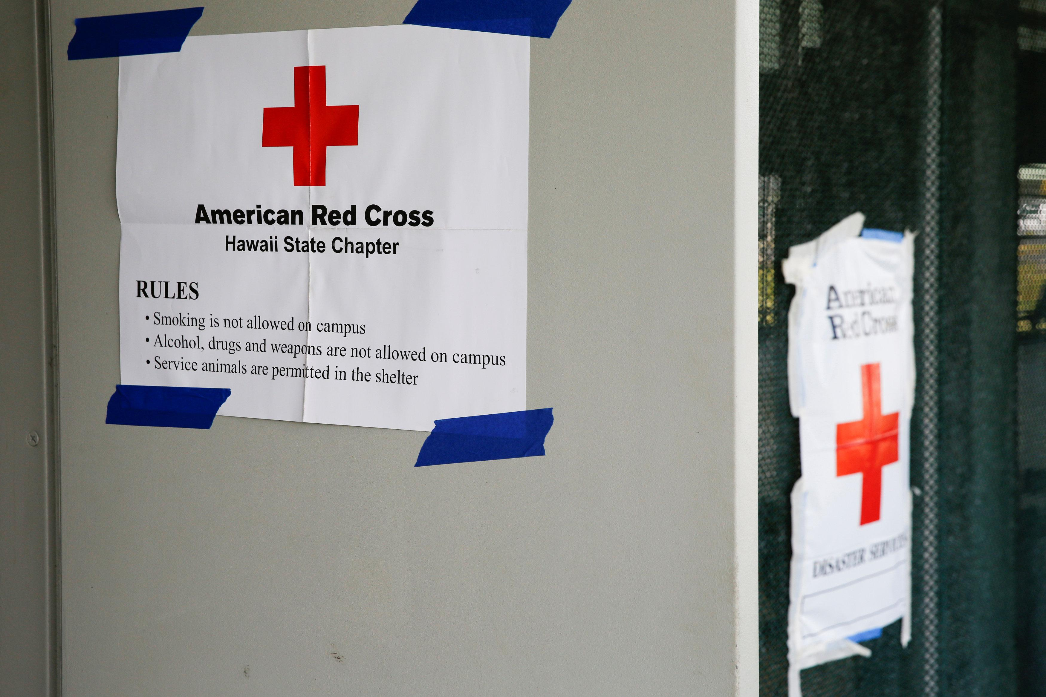 Signs hang in the entrance of an evacuation center in Pahoa available to residents of the Puna communities of Leilani Estates and Lanipuna Gardens, home to about 1,700 people, who were forced to leave their homes after the Kilauea Volcano, one of five on the island, erupted on Thursday after a series of earthquakes over the last couple of days, in Hawaii, U.S., May 4, 2018.  Terray Sylvester