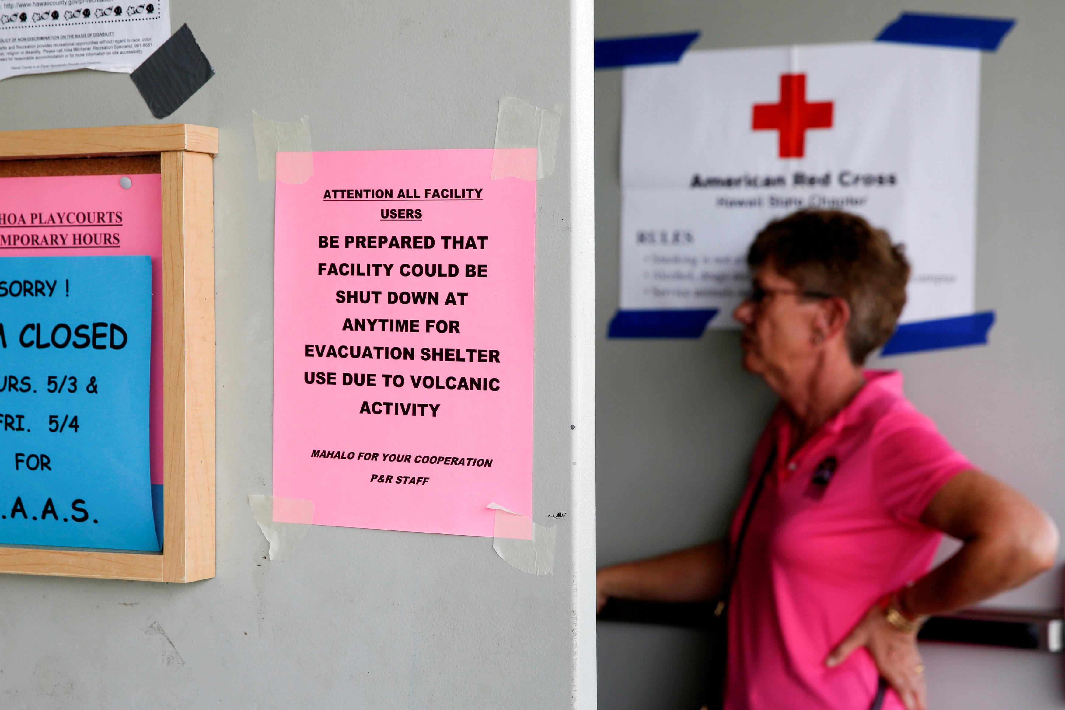 Signs hang in the entrance of an evacuation center in Pahoa available to residents of the Puna communities of Leilani Estates and Lanipuna Gardens who were forced to leave their homes after the Kilauea Volcano erupted on Thursday in Hawaii, U.S., May 4, 2018.  Terray Sylvester