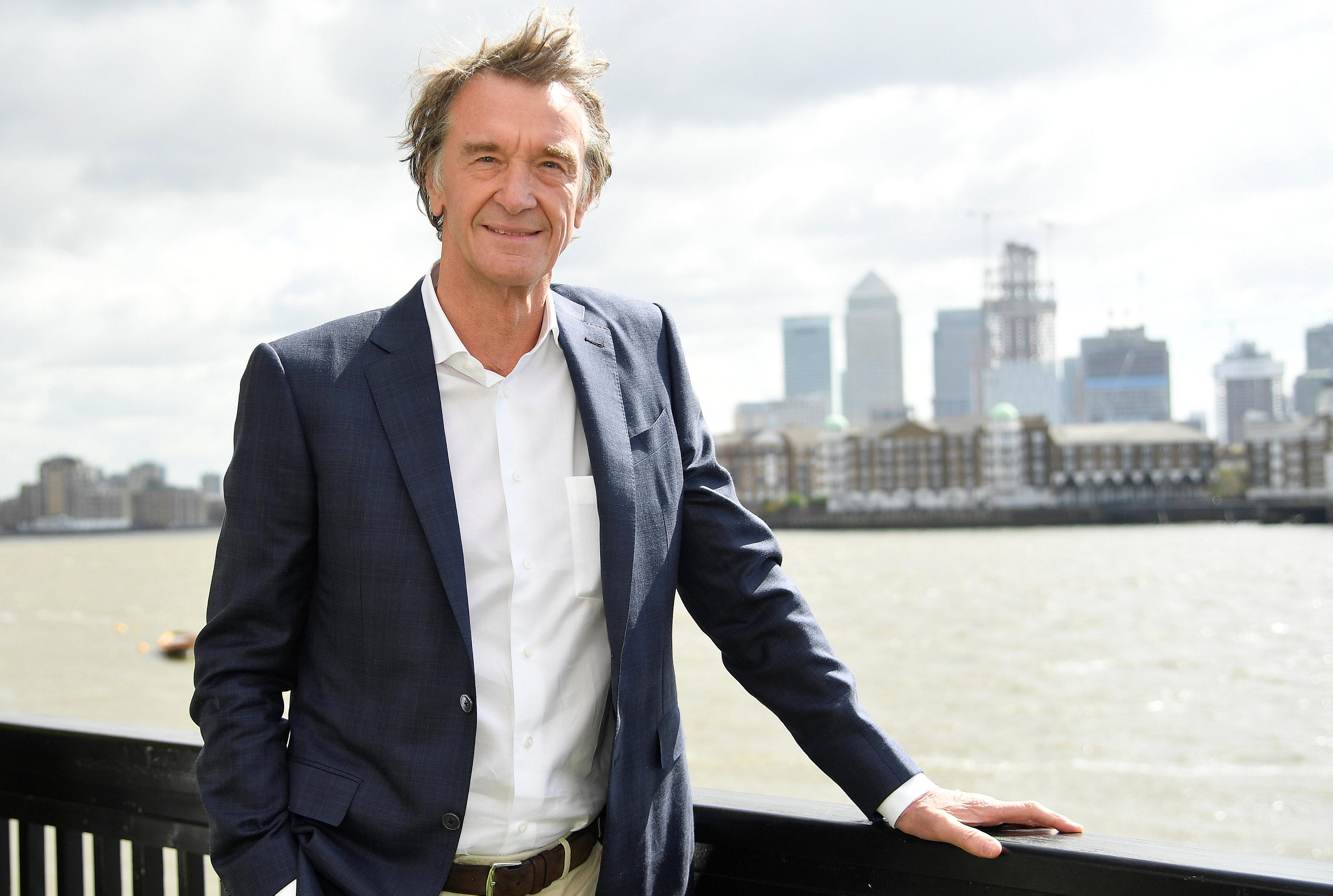 Jim Ratcliffe, CEO of British petrochemicals company INEOS, poses for a portrait with the Canary Wharf financial district seen behind, ahead of a news conference announcing the launch of a British America's Cup sailing team in London, Britain, April 26, 2018. Toby Melville