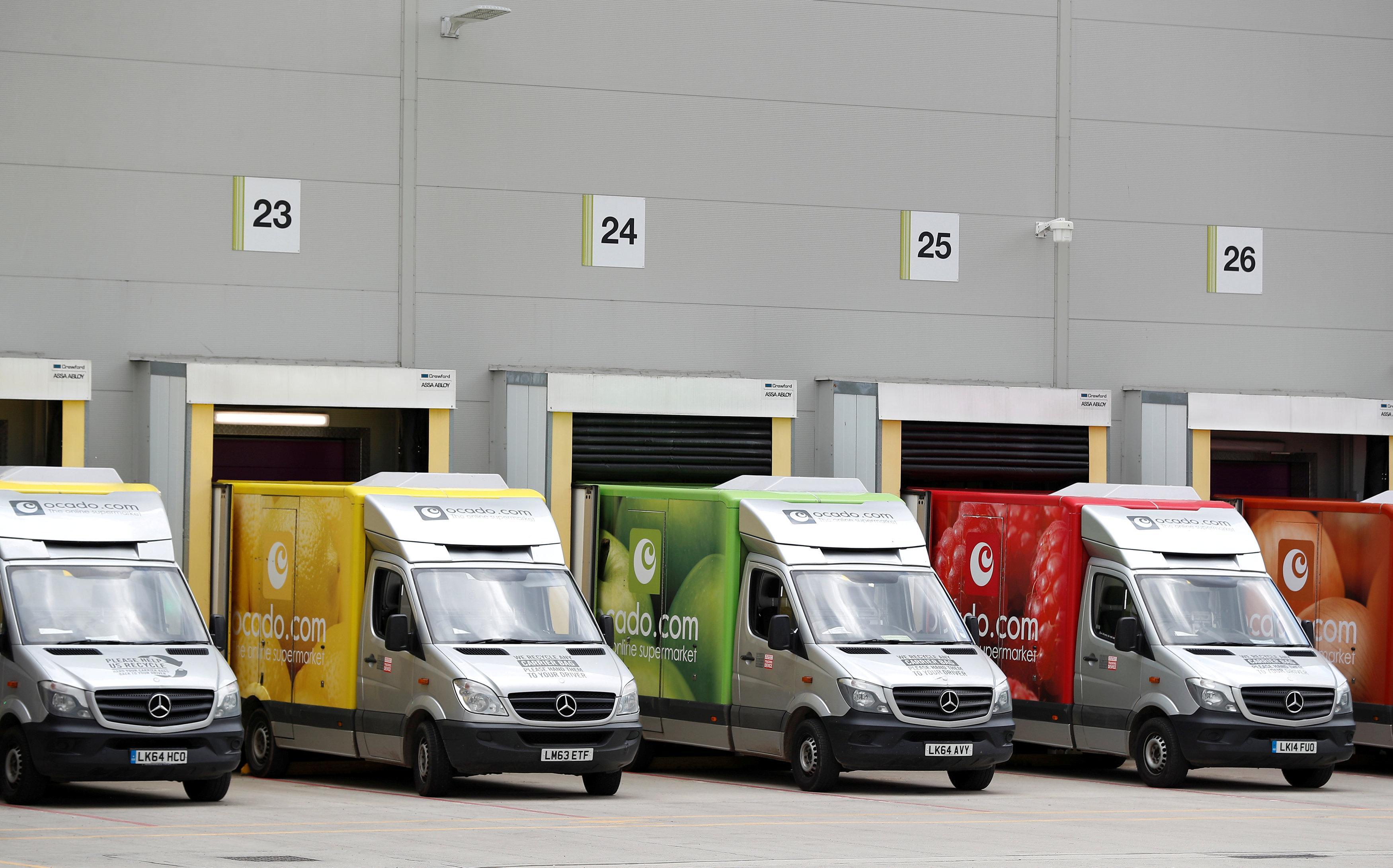 Delivery vans are lined up prior to dispatch at the Ocado CFC (Customer Fulfilment Centre) in Andover, Britain May 1, 2018.  Peter Nicholls