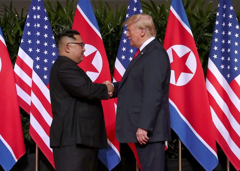 U.S. President Donald Trump shakes hands with North Korean leader Kim Jong Un at the Capella Hotel on Sentosa island in Singapore June 12, 2018. Jonathan Ernst
