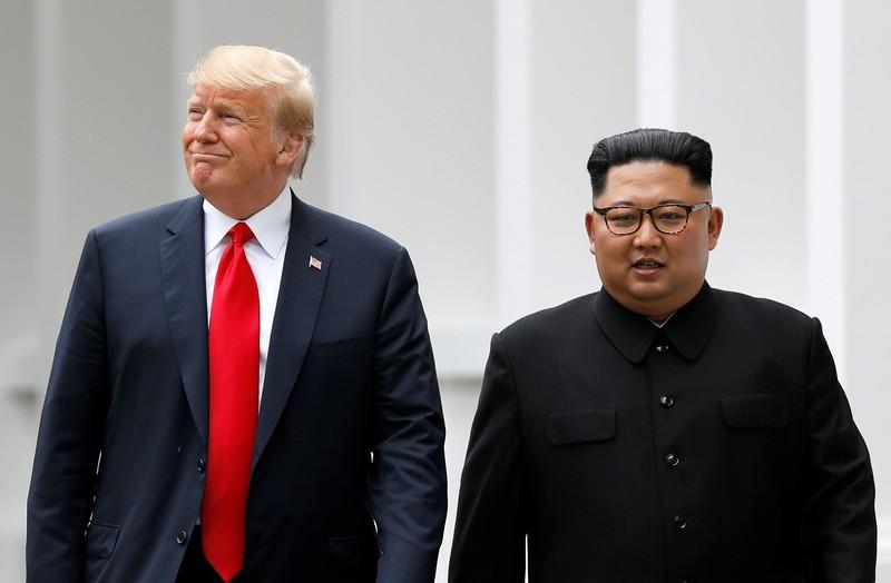 U.S. President Donald Trump and North Korean leader Kim Jong Un walk after lunch at the Capella Hotel on Sentosa island in Singapore June 12, 2018. Jonathan Ernst