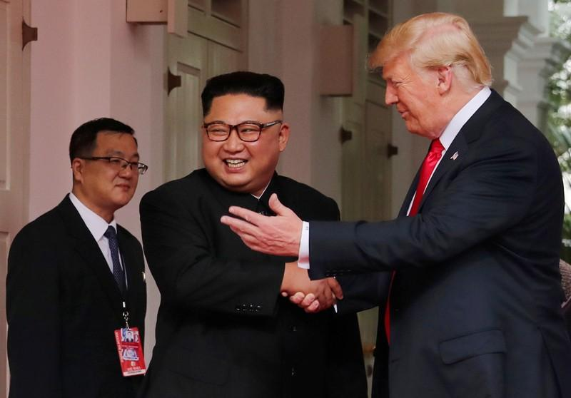 U.S. President Donald Trump shakes hands with North Korea's leader Kim Jong Un at the Capella Hotel on Sentosa island in Singapore June 12, 2018. Jonathan Ernst