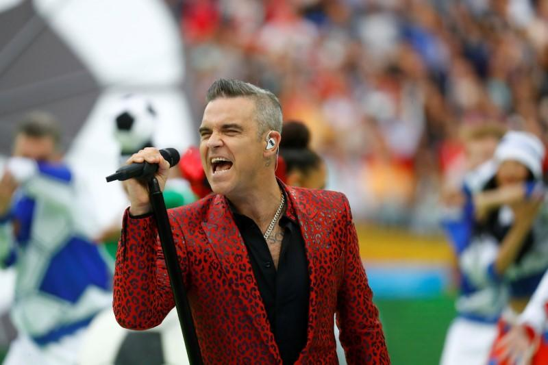Soccer Football - World Cup - Opening Ceremony - Luzhniki Stadium, Moscow, Russia - June 14, 2018  Robbie Williams performs during the opening ceremony  Kai Pfaffenbach