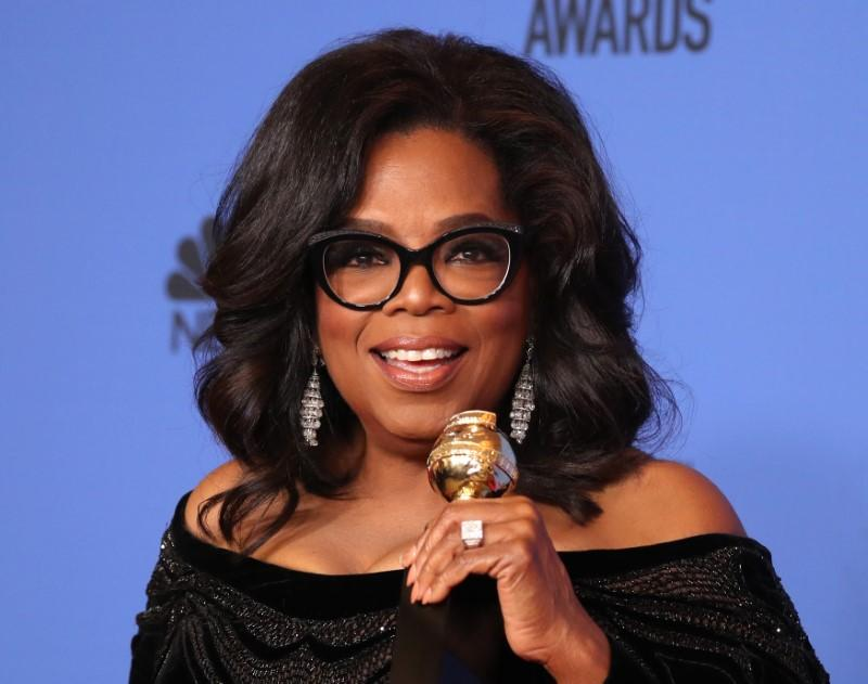 75th Golden Globe Awards – Photo Room – Beverly Hills, California, U.S., 07/01/2018 – Oprah Winfrey poses backstage with her Cecil B. DeMille Award. Lucy Nicholson