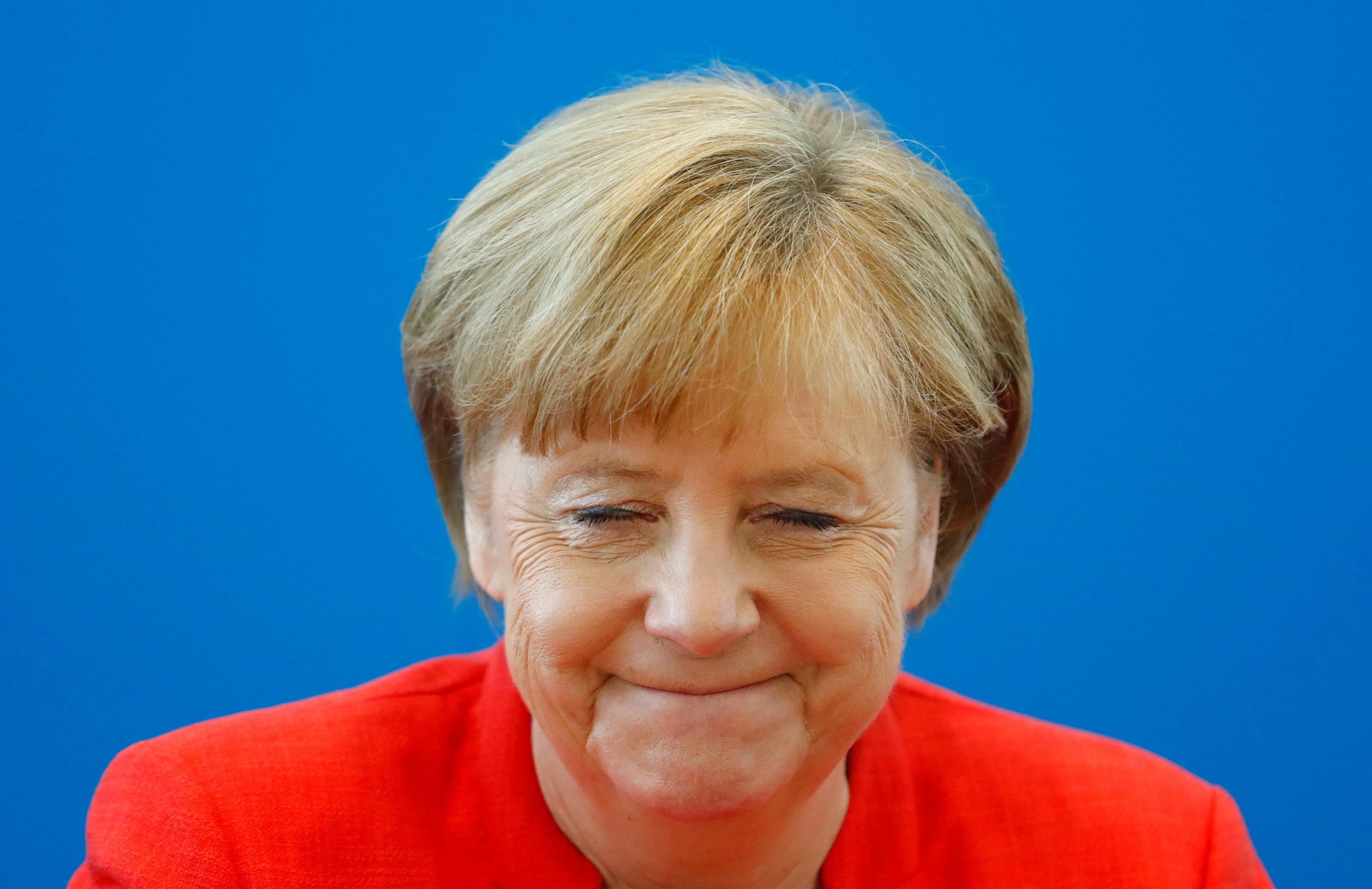 German Chancellor Angela Merkel reacts as she attends the board meeting of Germany's Christian Democratic Union (CDU) in Berlin, Germany, June 18 2018. Hannibal Hanschke