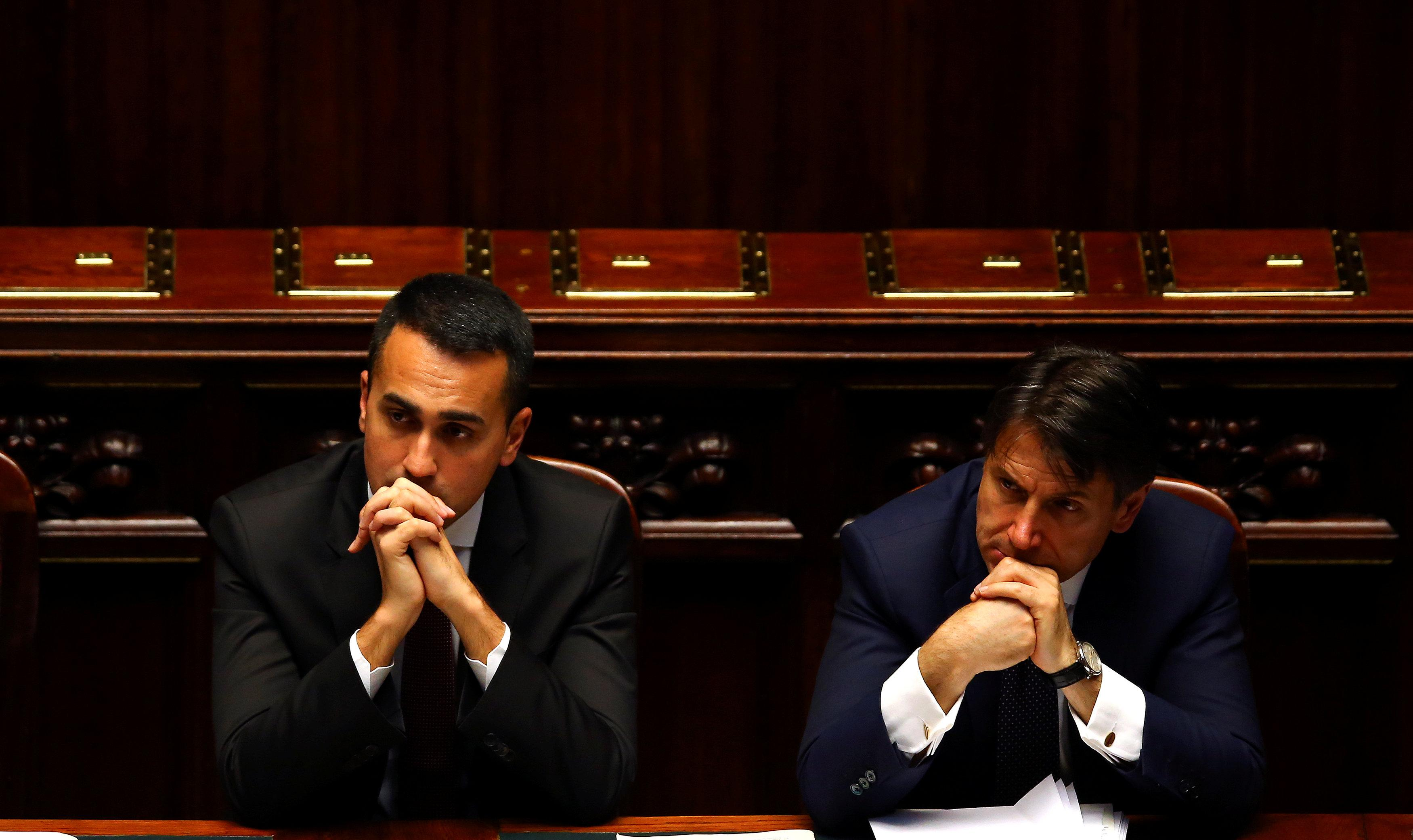 Italian Minister of Labor and Industry Luigi Di Maio listens next to Prime Minister Giuseppe Conte during his first session at the Lower House of the Parliament in Rome, Italy, June 6, 2018. Tony Gentile