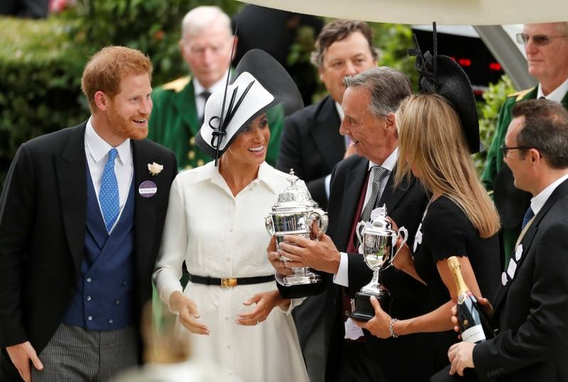 Horse Racing - Royal Ascot - Ascot Racecourse, Ascot, Britain - June 19, 2018    Britain's Prince Harry and Meghan, the Duchess of Sussex during a trophy presentation   Action Images via Reuters/Andrew Boyers