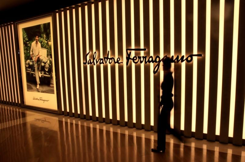 A woman walks past a Salvatore Ferragamo shop in Singapore May 19, 2017. Thomas White/