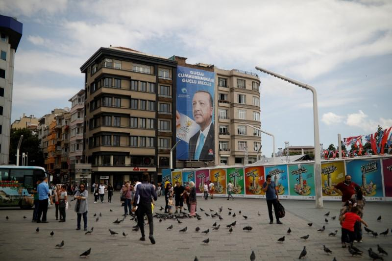 A pre-election poster depicting Turkish President Tayyip Erdogan reads