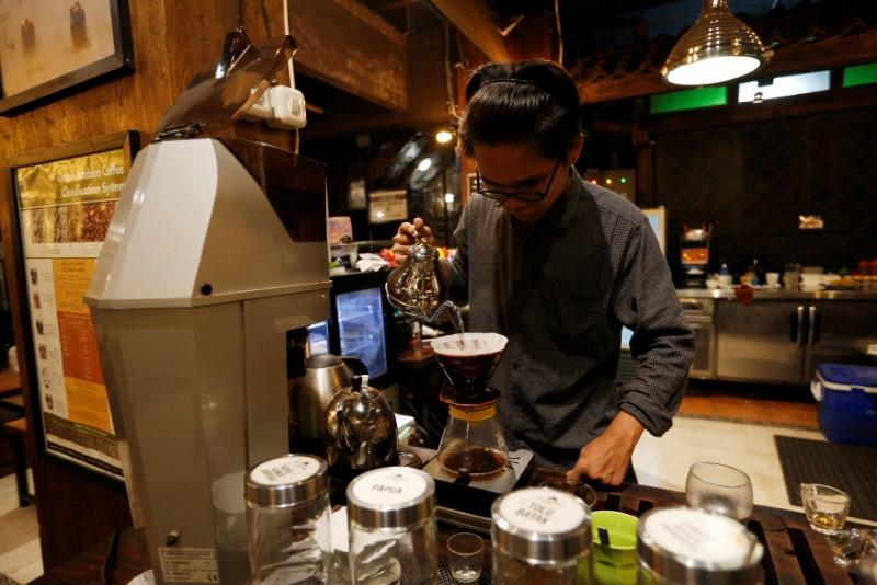A barista brews locally gown coffee at Jack Runner Roastery and cafe in Bandung, West Java, Indonesia, May 3, 2018. Willy Kurniawan