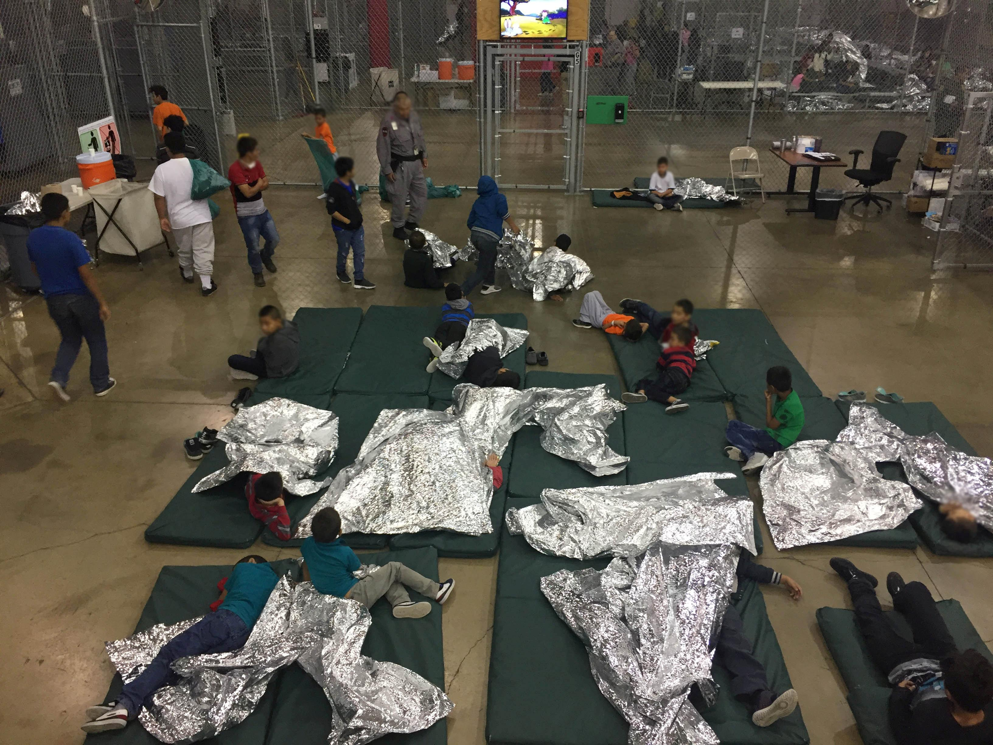 A view of inside U.S. Customs and Border Protection (CBP) detention facility shows children at Rio Grande Valley Centralized Processing Center in Rio Grande City, Texas, U.S., June 17, 2018.   Courtesy CBP/Handout via