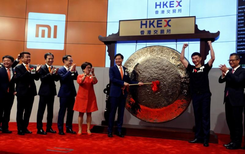 Xiaomi founder, Chairman and CEO Lei Jun hits the gong during the listing of the company at the Hong Kong Exchanges in Hong Kong, China July 9, 2018.   Bobby Yip