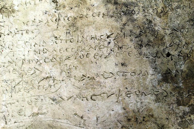 An undated handout picture released by the Greek Culture Ministry shows a clay plaque discovered in Ancient Olympia with an engraved inscription depicting thirteen verses from the Odyssey's 14th Rhapsody, in Ancient Olympia, Greece. Greek Culture Ministry/Handout via