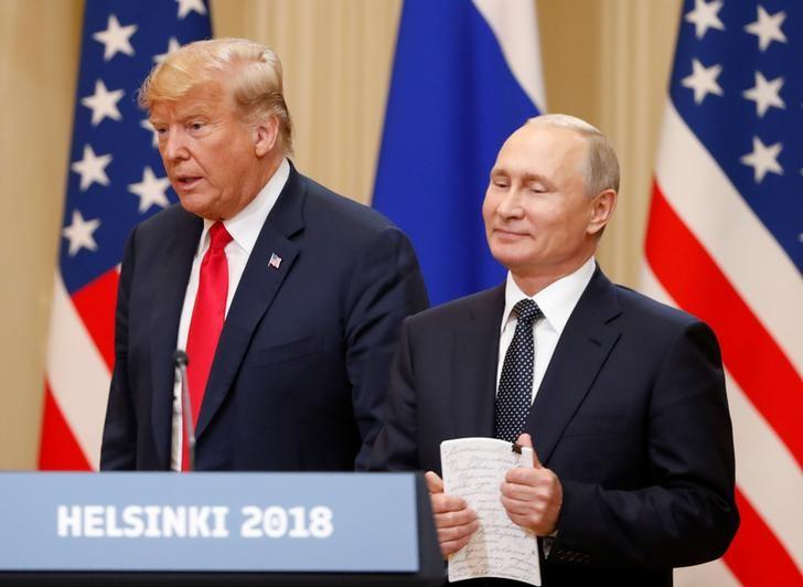 U.S. President Donald Trump and Russian President Vladimir Putin arrive for a joint news conference after their meeting in Helsinki, July 16, 2018. Grigory Dukor