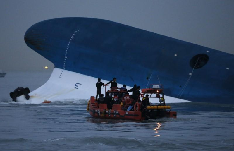 Maritime police search for missing passengers in front of the South Korean ferry