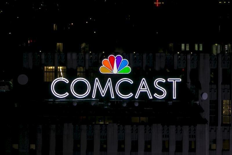 The NBC and Comcast logo are displayed on top of 30 Rockefeller Plaza, formerly known as the GE building, in midtown Manhattan in New York July 1, 2015.  Brendan McDermid