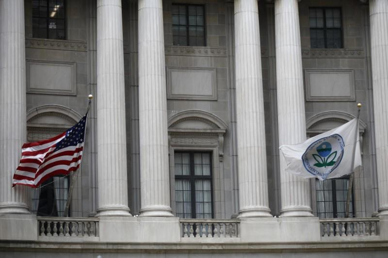 Flags fly outside the U.S. Environmental Protection Agency (EPA) at EPA headquarters in Washington, U.S., July 11, 2018. Ting Shen