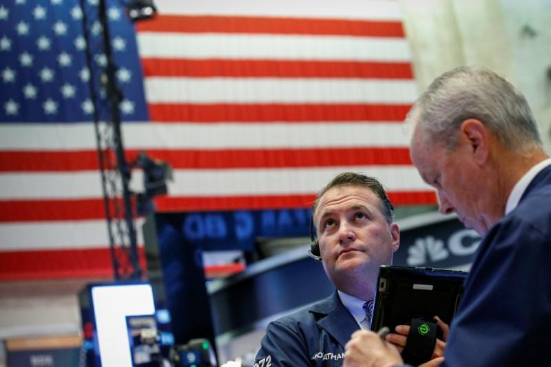 Traders work on the floor of the New York Stock Exchange (NYSE) in New York, U.S., July 11, 2018. Brendan McDermid