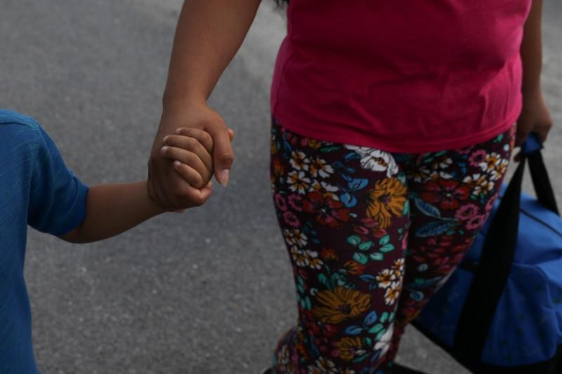 Dunia, an asylum seeker from Honduras, is reunited with her five-year-old son Wilman at Brownsville South Padre International Airport in Brownsville, Texas, U.S., following their separation of more than five weeks through the Trump administration