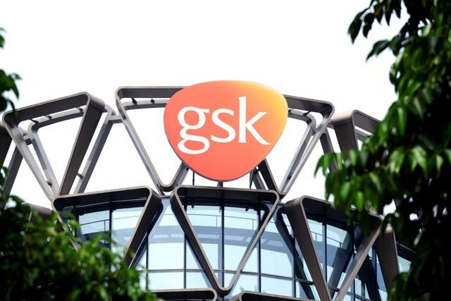 The GlaxoSmithKline (GSK) logo is seen on top of GSK Asia House in Singapore, March 21, 2018. Picture taken March 21, 2018. Loriene Perera