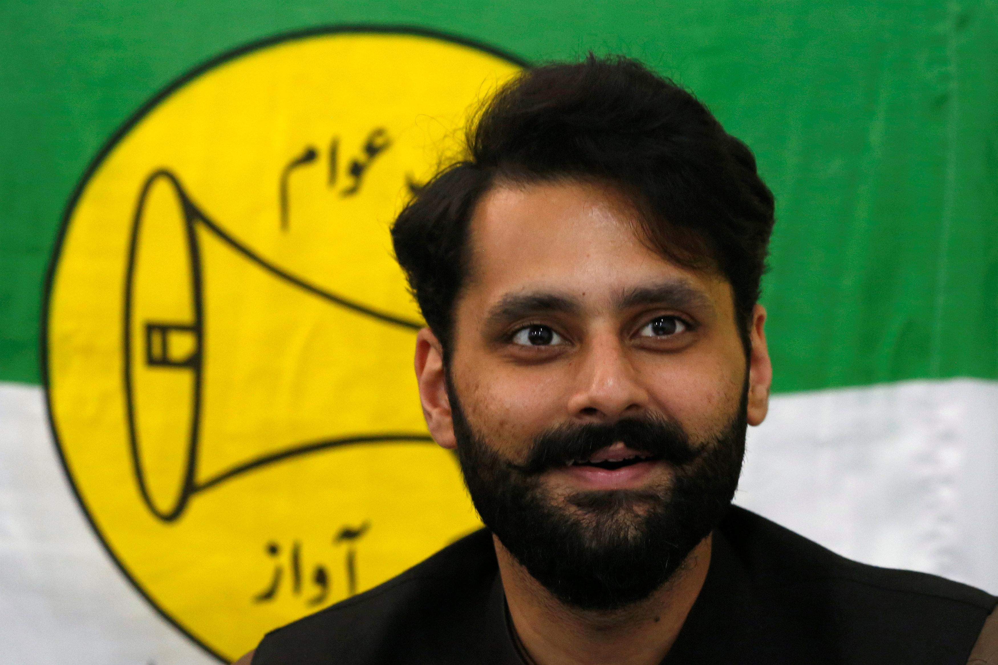 Jibran Nasir, a human rights lawyer and independent candidate for general election, speaks at his office in Karachi, Pakistan July 23, 2018. Akhtar Soomro