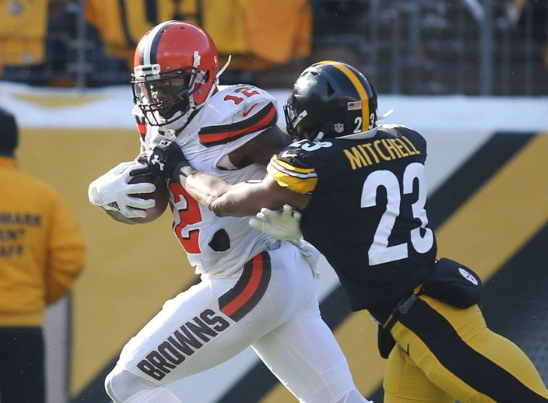 Dec 31, 2017; Pittsburgh, PA, USA;  Cleveland Browns wide receiver Josh Gordon (12) runs after a catch against Pittsburgh Steelers free safety Mike Mitchell (23) during the second quarter at Heinz Field. Mandatory Credit: Charles LeClaire-USA TODAY Sports