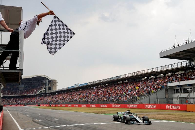 Formula One F1 - German Grand Prix - Hockenheimring, Hockenheim, Germany - July 22, 2018 - Mercedes' Lewis Hamilton crosses the finish line. Valdrin Xhemaj/Pool via