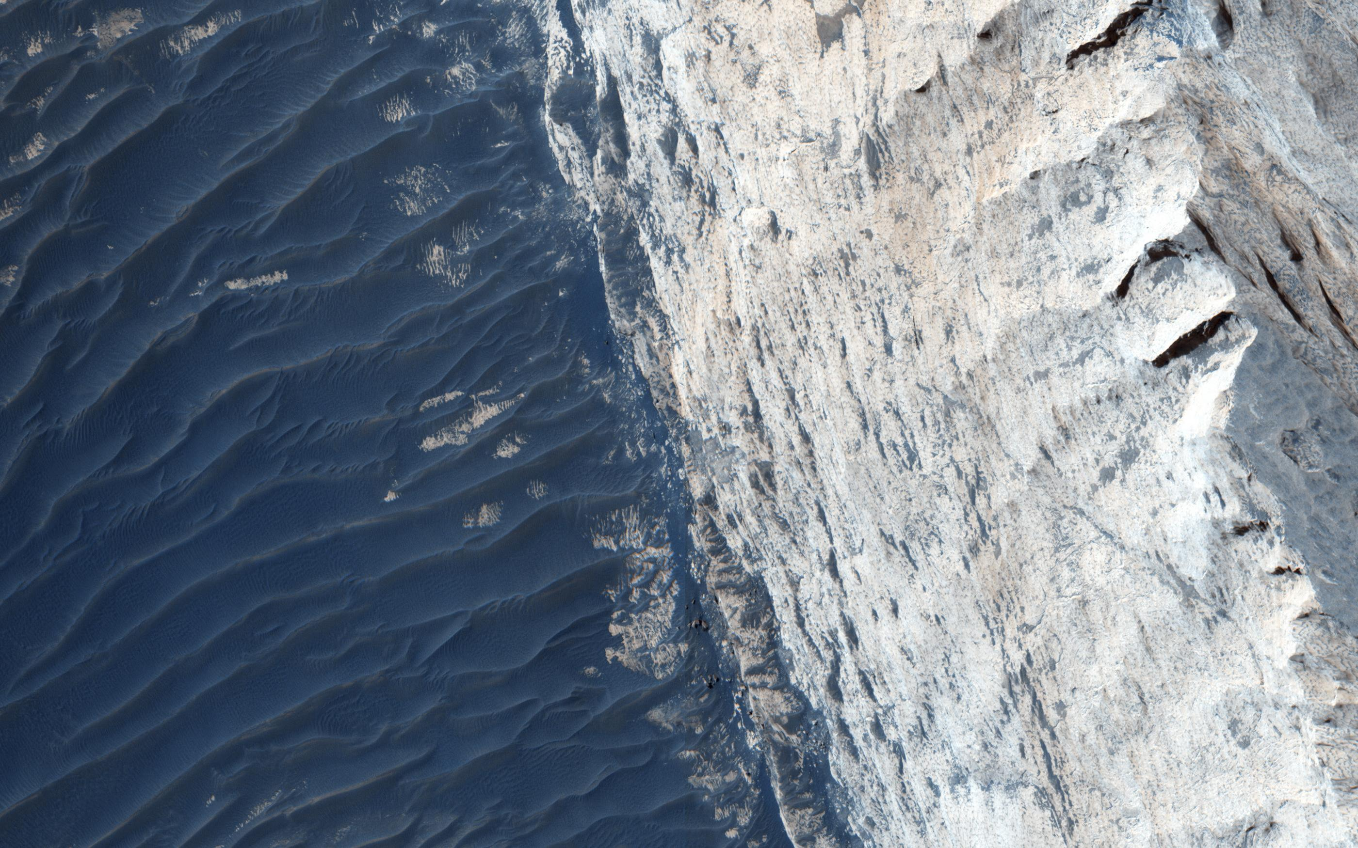 A view of Ophir Chasma on the northern portion of the vast Mars canyon system, Vallles Marineris, taken by NASA's Mars Reconnaissance Orbiter.   NASA/JPL/University of Arizona
