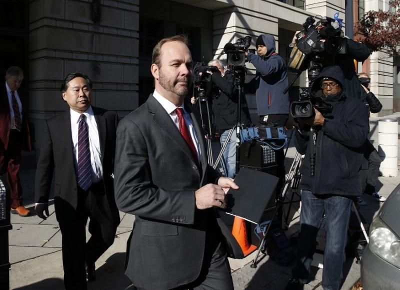 Rick Gates, former campaign aide to U.S. President Donald Trump, departs after a bond hearing at U.S. District Court in Washington, U.S., December 11, 2017. Joshua Roberts
