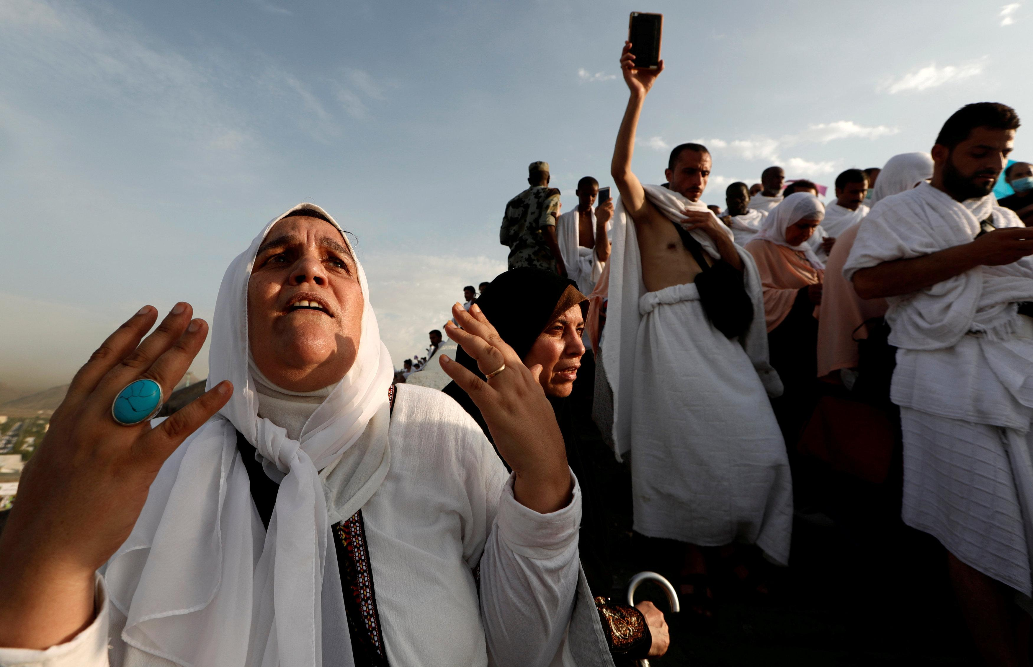 A Muslim pilgrim prays as she gather with others on Mount Mercy on the plains of Arafat during the annual haj pilgrimage, outside the holy city of Mecca, Saudi Arabia August 20, 2018. Zohra Bensemra