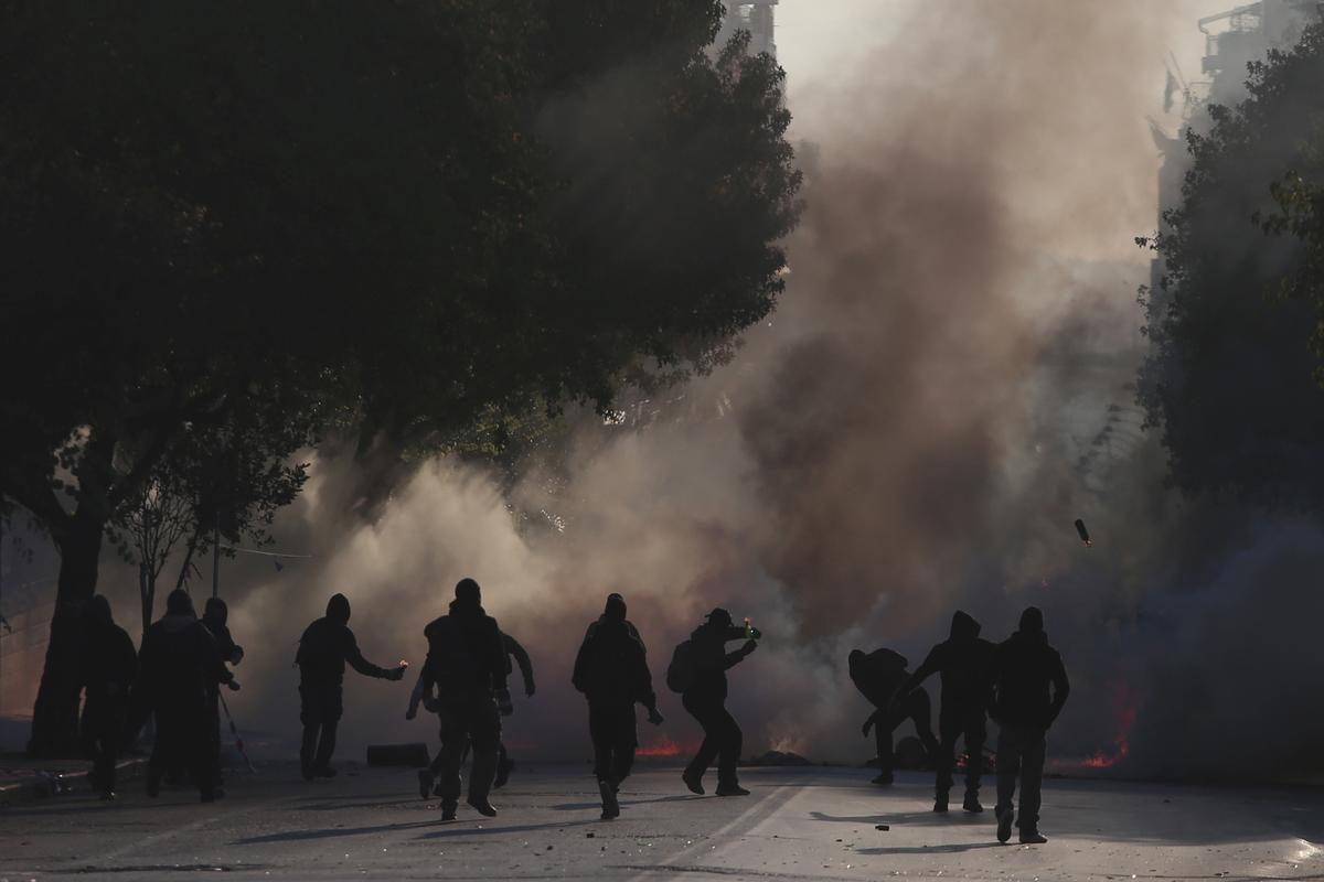 Greek youths march to mark anniversary of police shooting of teenager