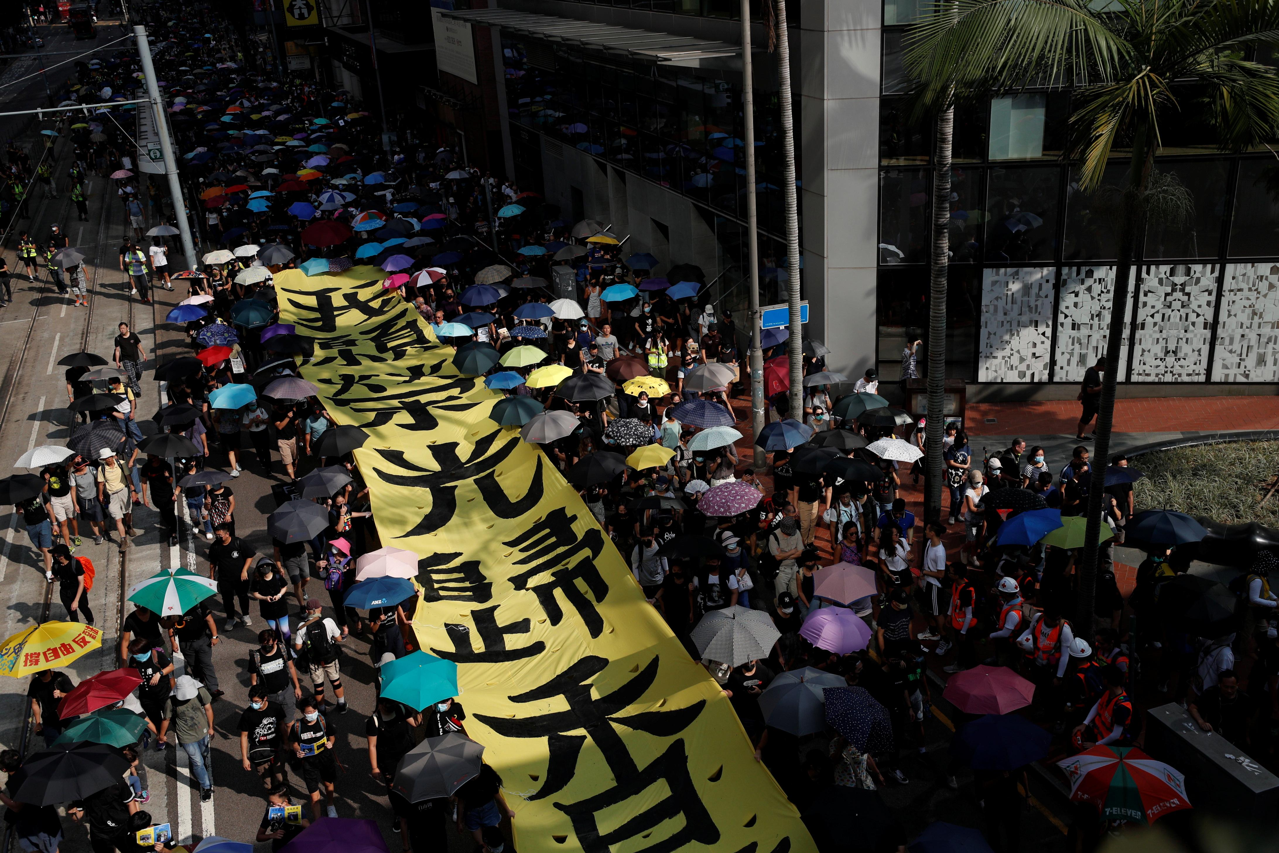 Hundreds return to Hong Kong streets as metro, shops shut after violence