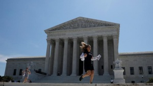 News assistants run outside the U.S. Supreme Court after the court ruled that U.S. President Donald Trump's administration did not give an adequate explanation for its plan to add a citizenship question to the 2020 census, delivering a victory to New York state and others challenging the proposal in Washington, U.S., June 27, 2019. REUTERS/Carlos Barria