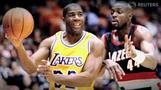 Magic Johnson consortium buys LA Dodgers, crown jewel in Magic's business...