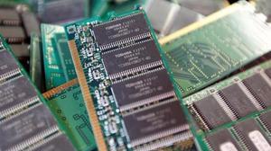 Toshiba shares slide as execs chase $18 billion deal