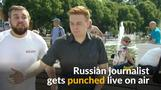 Russian reporter gets punched during live broadcast