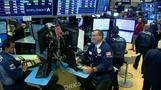 Wall St flat after late-day rally