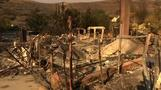 Residents return to burned-out homes in southern California