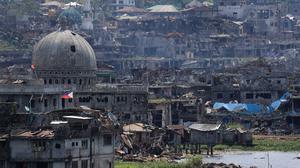 EXCLUSIVE: Plunder helps Philippines militants rebuild