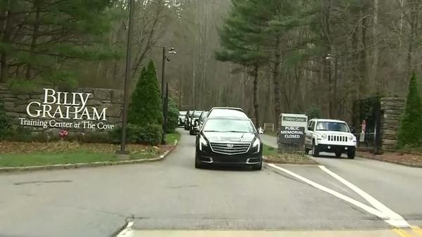 Spectators watch Billy Graham funeral procession