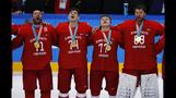 Russian ice hockey gold medallists sing national anthem