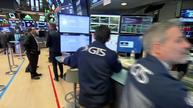 Stocks end higher despite rate jitters