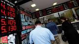 Erodgan's market fight sees Turkish lira tumble